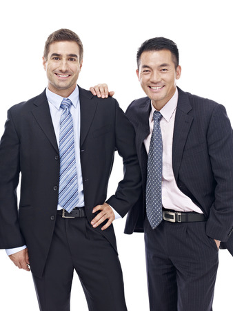 studio portrait of a caucasian and an asian businessmen, happy and smiling,  isolated on white background.