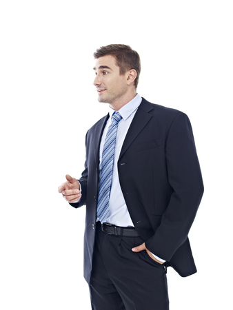 business attire: studio portrait of a caucasian businessman, side view, isolated on white background. Stock Photo