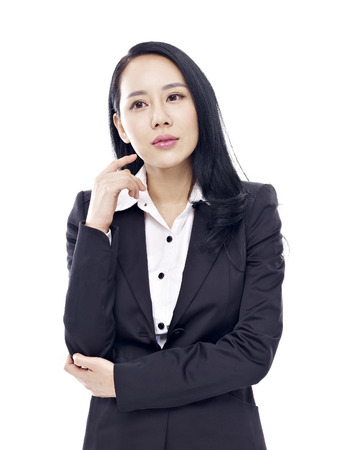 office attire: studio portrait of a young asian businesswoman, isolated on white background.