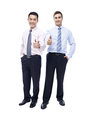 thumbup: asian and caucasian business executives showing the thumb-up sign looking at camera smiling, isolated on white background.