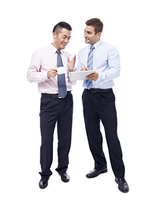 westerner: asian and caucasian business men having a discussion with coffee cup and tablet computer in hands, isolated on white background.