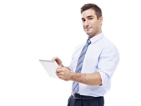 rolled up sleeves: caucasian corporate executive with tablet computer, side view, isolated on white background.