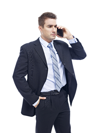 westerner: caucasian business person talking on cellphone looking serious and upset, isolated on white background.