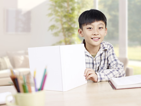 elementary: home portrait of a 10 year-old asian elementary schoolboy