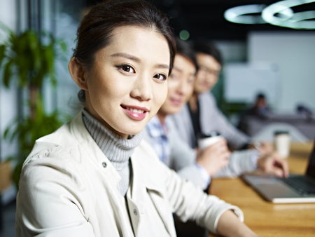 founder: portrait of a young asian business woman looking at camera during meeting in office.
