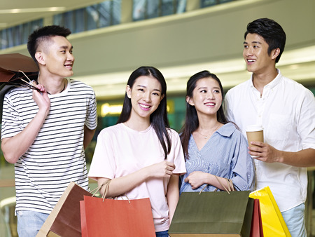 two young asian couples people shopping in a modern mall