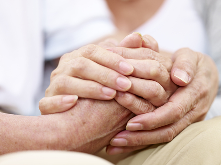 close-up of hands of a senior couple held together, concept for love, help, comforting and consoling Stock Photo