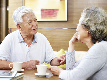 loving senior asian couple drinking coffee and chatting 版權商用圖片