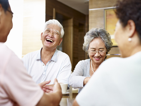 senior asian people getting together and having a good time Banco de Imagens