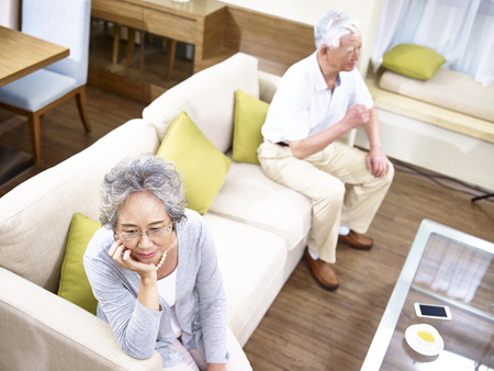 couple on couch: senior asian couple having relationship problem angry with each other, high angle view. Stock Photo