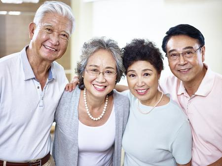 two senior asian couples looking at camera smiling. Stock Photo