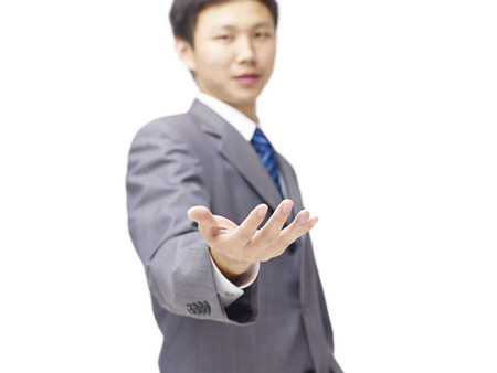 young asian business person in suit holding something with hand, isolated on white background.