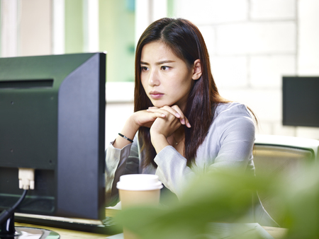 young asian businesswoman working in office using computer.