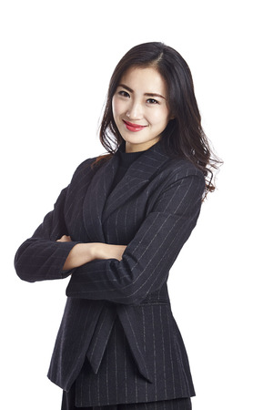 studio portrait of a young asian businesswoman in formal wear, arms crossed, isolated on white background.
