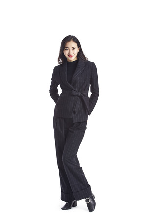 studio portrait of a young asian businesswoman in formal wear, isolated on white background.