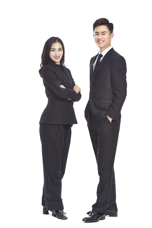 studio portrait of young asian business man and woman, looking at camera smiling, isolated on white background. Stock Photo - 82805904