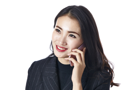 young asian business woman talking on mobile phone, isolated on white background.