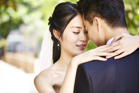 close-up portrait of intimate wedding couple. Foto de archivo