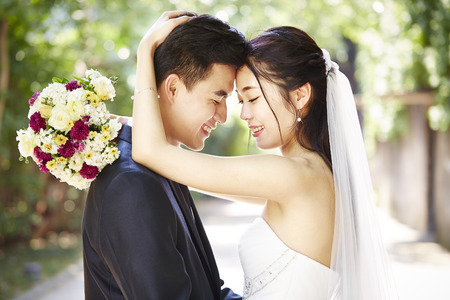 close-up portrait of intimate wedding couple. Stock Photo