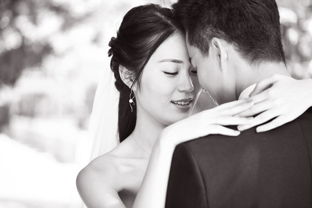 close-up portrait of intimate wedding couple, black and white. Stock Photo