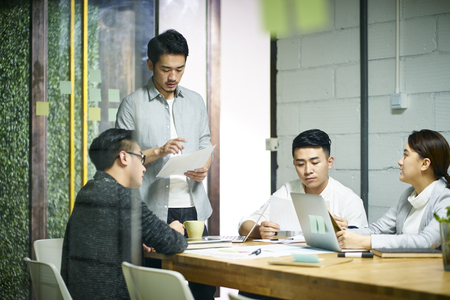 young asian entrepreneurs of small company discussing business plan in office meeting room. Standard-Bild - 120405680