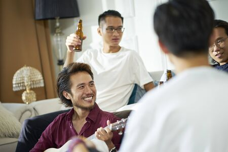 young asian adult men drinking beer at home Reklamní fotografie - 129550849