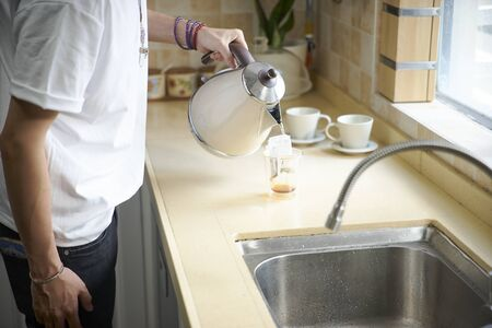 young asian man making a cup of drip coffee Reklamní fotografie - 129686513