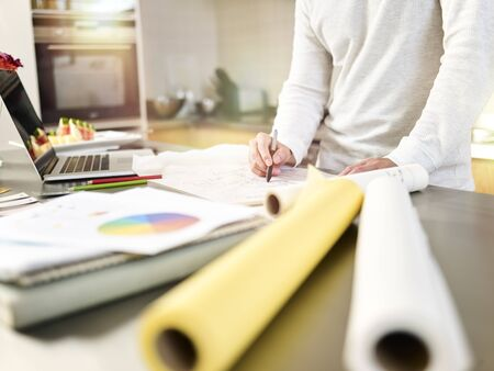 close-up shot of a young asian male designer drawing on drafting paper Stock Photo