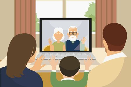 asian family with child greeting and talking to grandparents using laptop via video call
