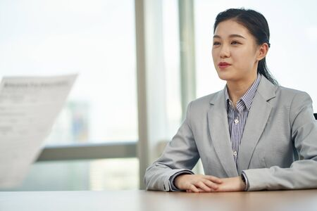 young asian woman looking for employment talking to interviewer during job interview