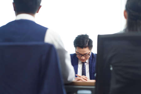 young asian business man looking sad after learning termination of employment Stockfoto