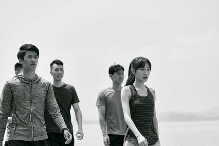 group of five young asian adults taking a walking outdoors after exercising, black and white 免版税图像