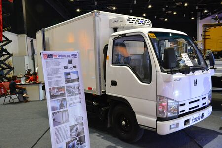 PASAY, PH - AUG. 17: Isuzu Elf delivery van on August 17, 2018 at Transport and Logistics in World Trade Center Metro Manila, Pasay, Philippines.