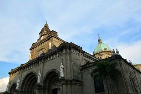 MANILA, PH - OCT. 5: Manila Cathedral church facade at Intramuros walled city on October 5, 2019 in Manila, Philippines.