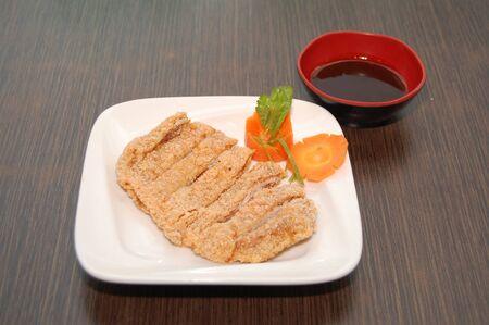 Chicken chops strips on plate Фото со стока