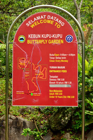 SABAH, MY - JUNE 18: Poring Hot Spring butterfly garden sign on June 18, 2016 in Sabah, Malaysia. Poring is situated in lowland rainforest, contrasting with the montane and submontane rainforest of Kinabalu National Park.