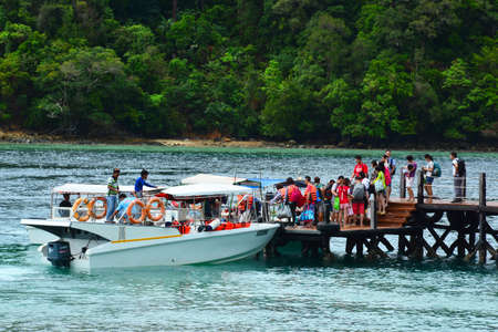 SABAH, MY - JUNE 20: Sapi Island footbridge and dock on June 20, 2016 in Sabah, Malaysia. Sapi Island is a hideaway that is one of the five tropical islands that comprise the Tunku Abdul Rahman Park.