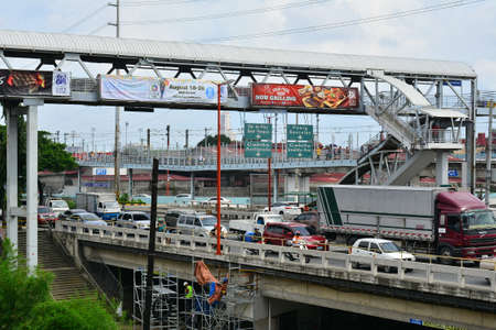 MARIKINA, PH - AUG. 25: Marcos highway and bridge on August 25, 2018 in Marikina, Philippines. Marcos highway is one of the major roads in the Philippines. Editorial