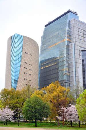 OSAKA, JP - APRIL 8 - NHK Japan Broadcasting Corporation building glass facade on April 8, 2017 in Osaka, Japan. NHK is Japan's national public news organization.