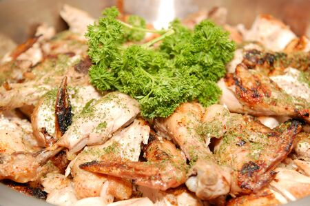 Peri peri chicken with parsley leaves