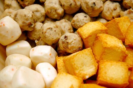 Cooked tofu, beef balls and cheese bun balls for hot pot soup mix