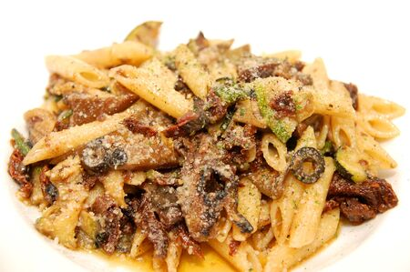 Pasta mediterranea with anchovies on penne