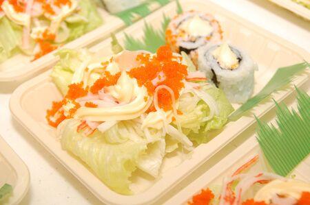 Kani salad Japanese raw vegetable mix food with California maki sushi