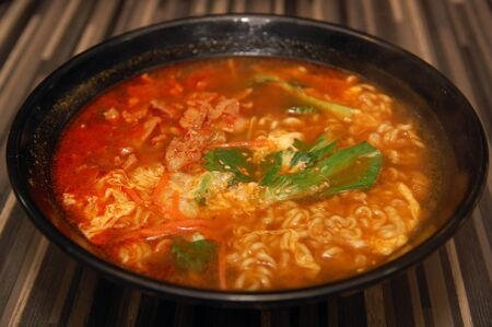 Spicy hot ramen Korean noodles with vegetable, soup, and meat