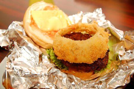Burger patty with onion ring in bun 版權商用圖片