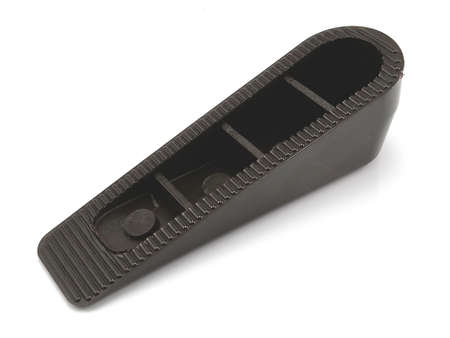 Black hard inclined plastic door stopper with ridges use to put underneath the door