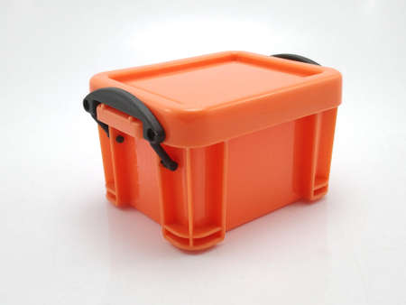 Small plastic orange storage box with lid on top and locks on sides use to put tiny items