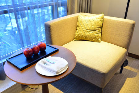 Complimentary ripe apples with knife, fork, cloth napkin, and plate furniture set up