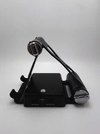 Foldable inclined stand powerbank charger use to charge low to empty battery of smartphone