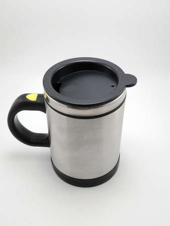 Self stirring mug made from aluminum metal with lid cover use to stir liquid content before drinking